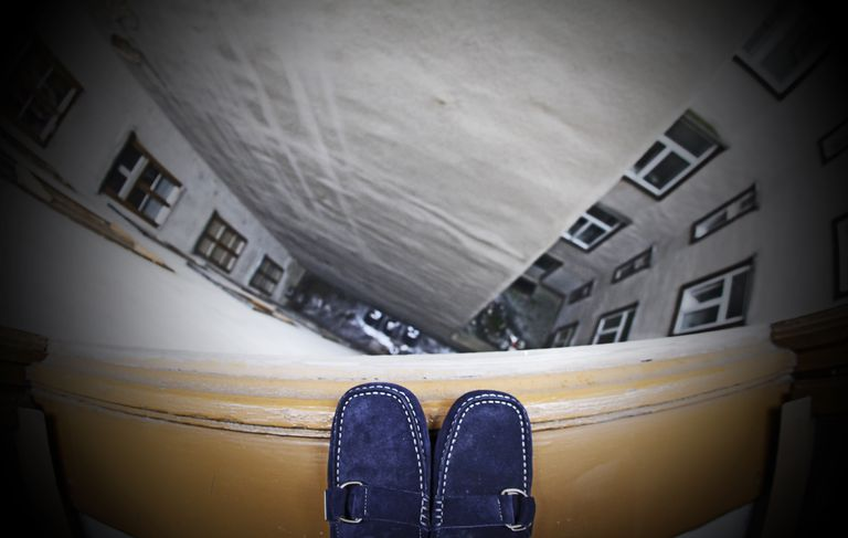 a person's feet standing on a ledge