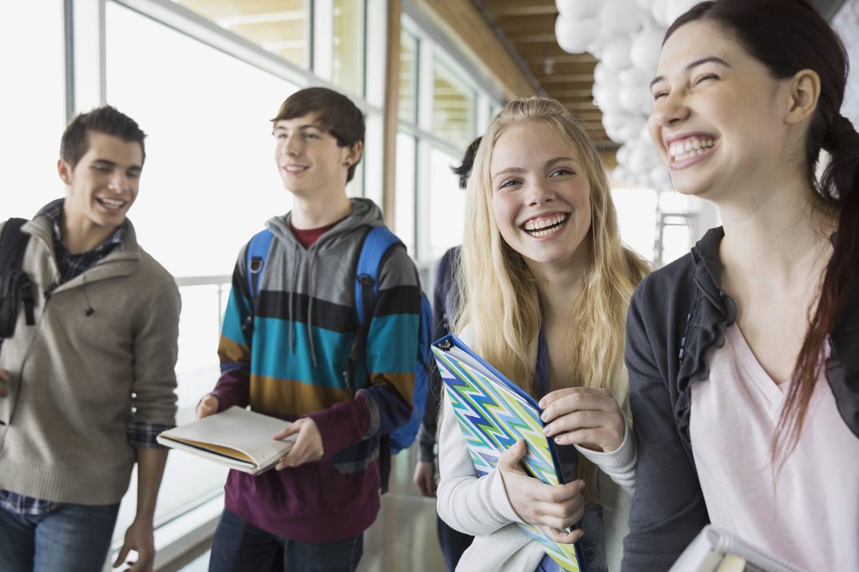 Adolescent students in a school hallway