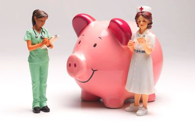 Three figurines: A pink pig, a woman in green scrubs with a clipboard, and woman in a white nurse's uniform