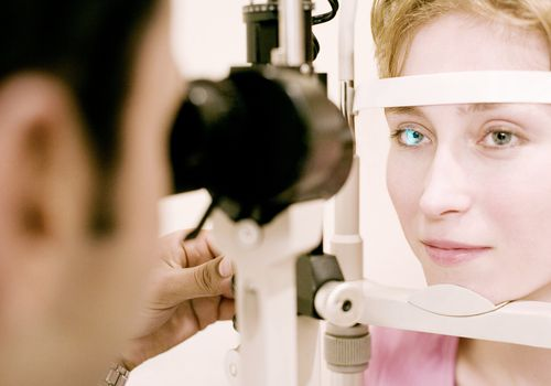 Woman getting cornea examined at doctor