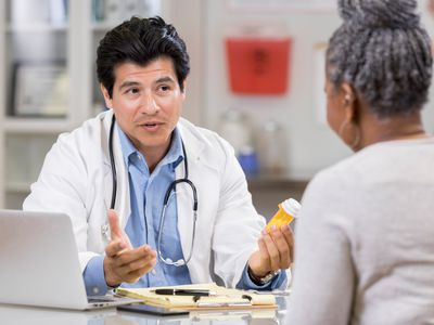 Serious doctor explains drug side effects to patient