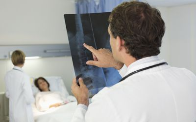a doctor examining an X-ray