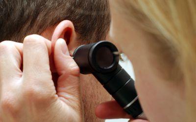 Doctor examining the ear