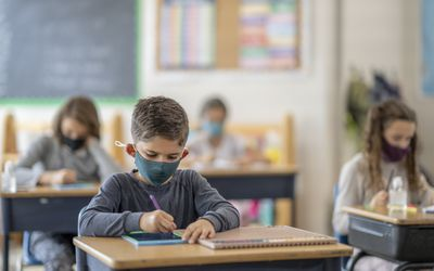 Child wearing a face mask at school.