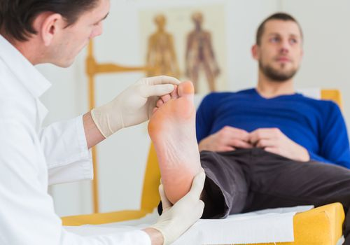 Doctor looking at a patients foot