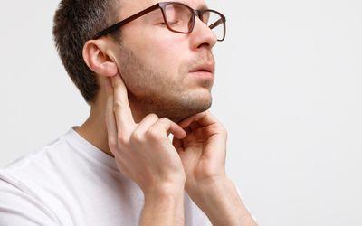man checking lymph nodes