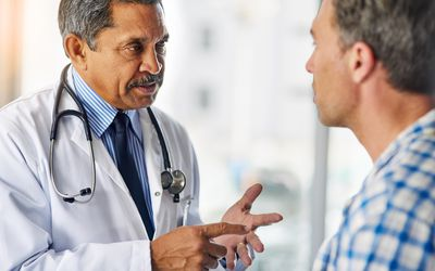 Doctor giving advice to patient