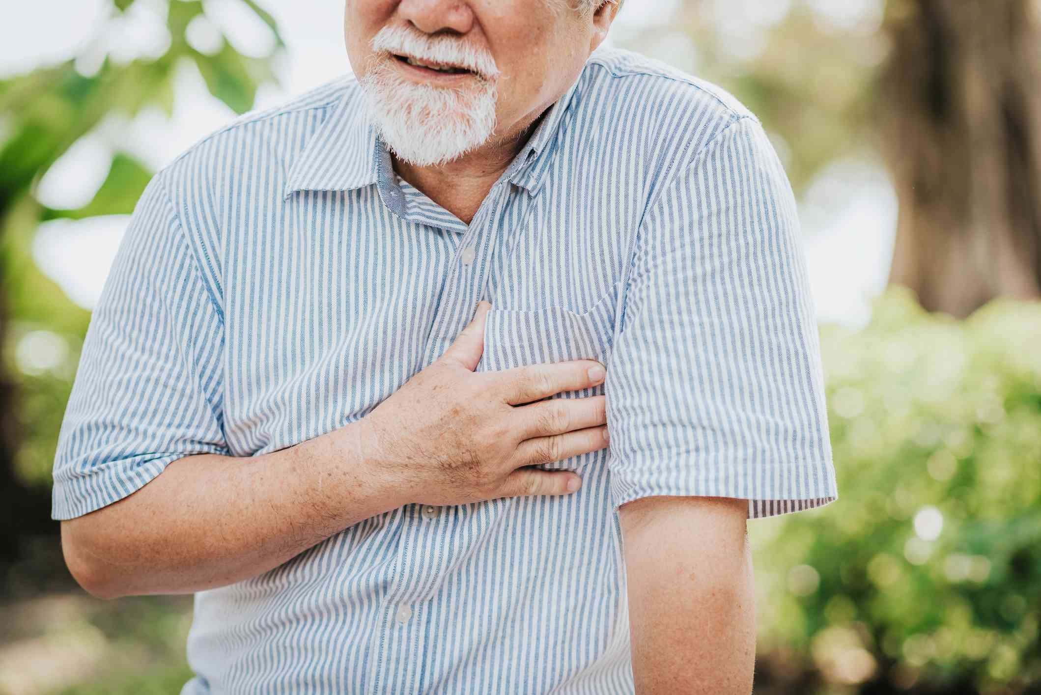A man holding his chest in pain