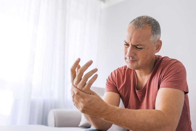 Man rubbing his sore hand