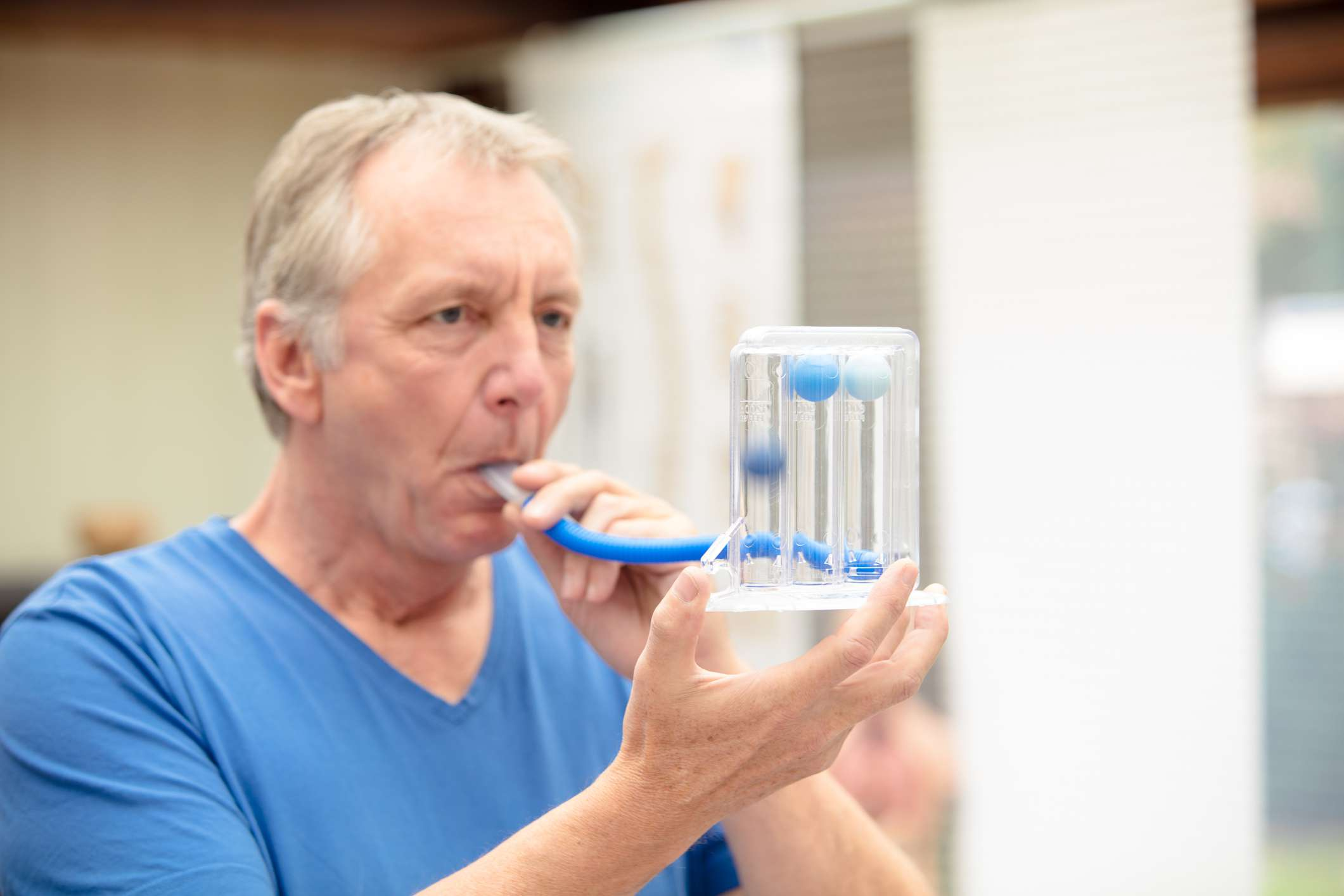 Man performing lung function test
