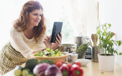 Woman using an iPad in a kitchen