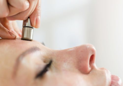 Diamond microdermabrasion skin face therapy in beauty spa