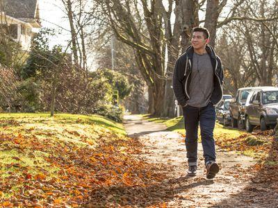 Man taking a walk in the fall