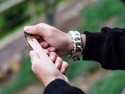 Close-up of person hand holding electronic cigarette