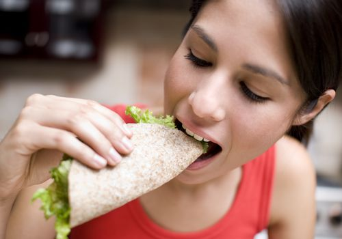 Woman eating a taco