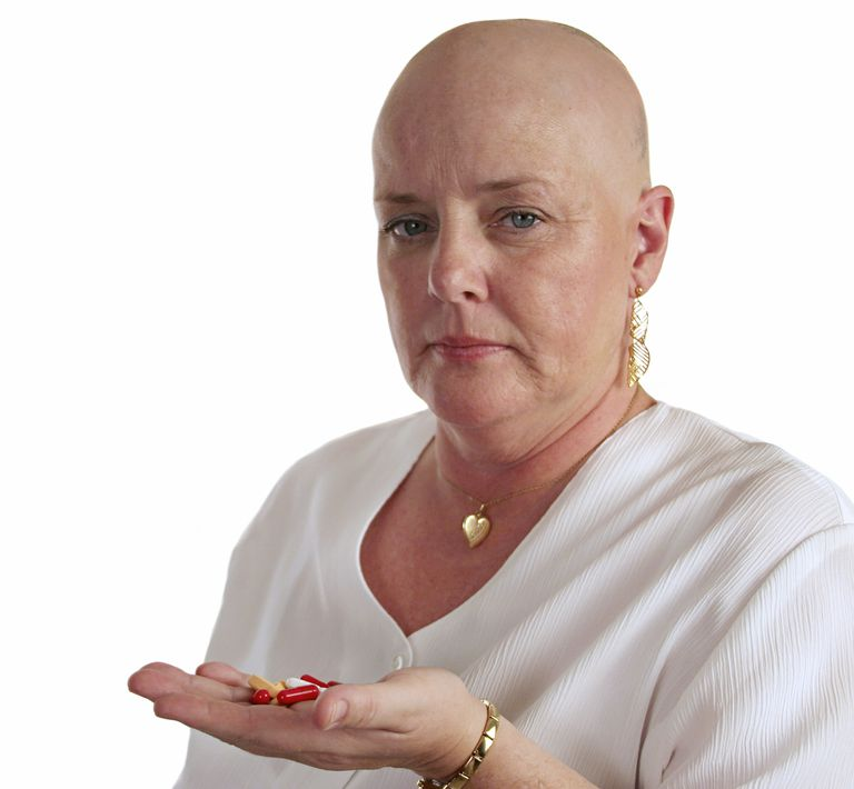 bald woman contemplating maintenance therapy pills