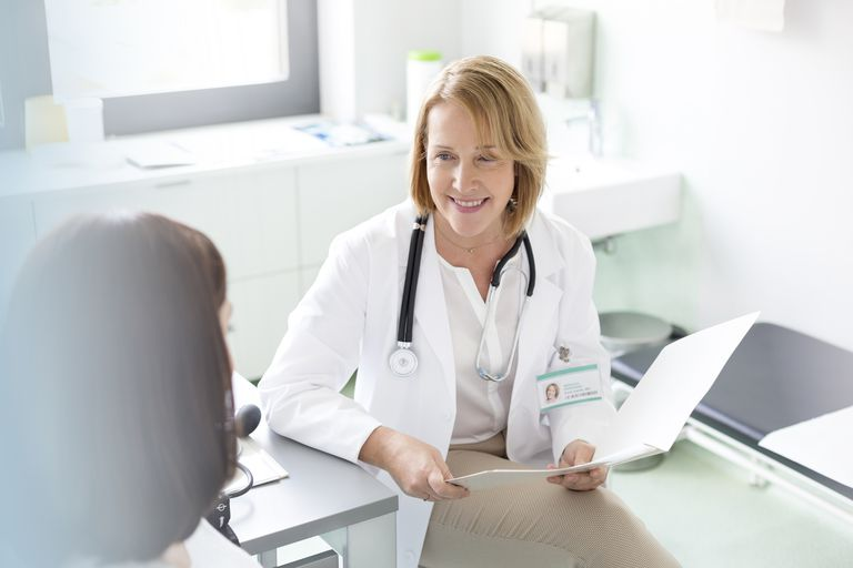 female doctor talking to patient in office