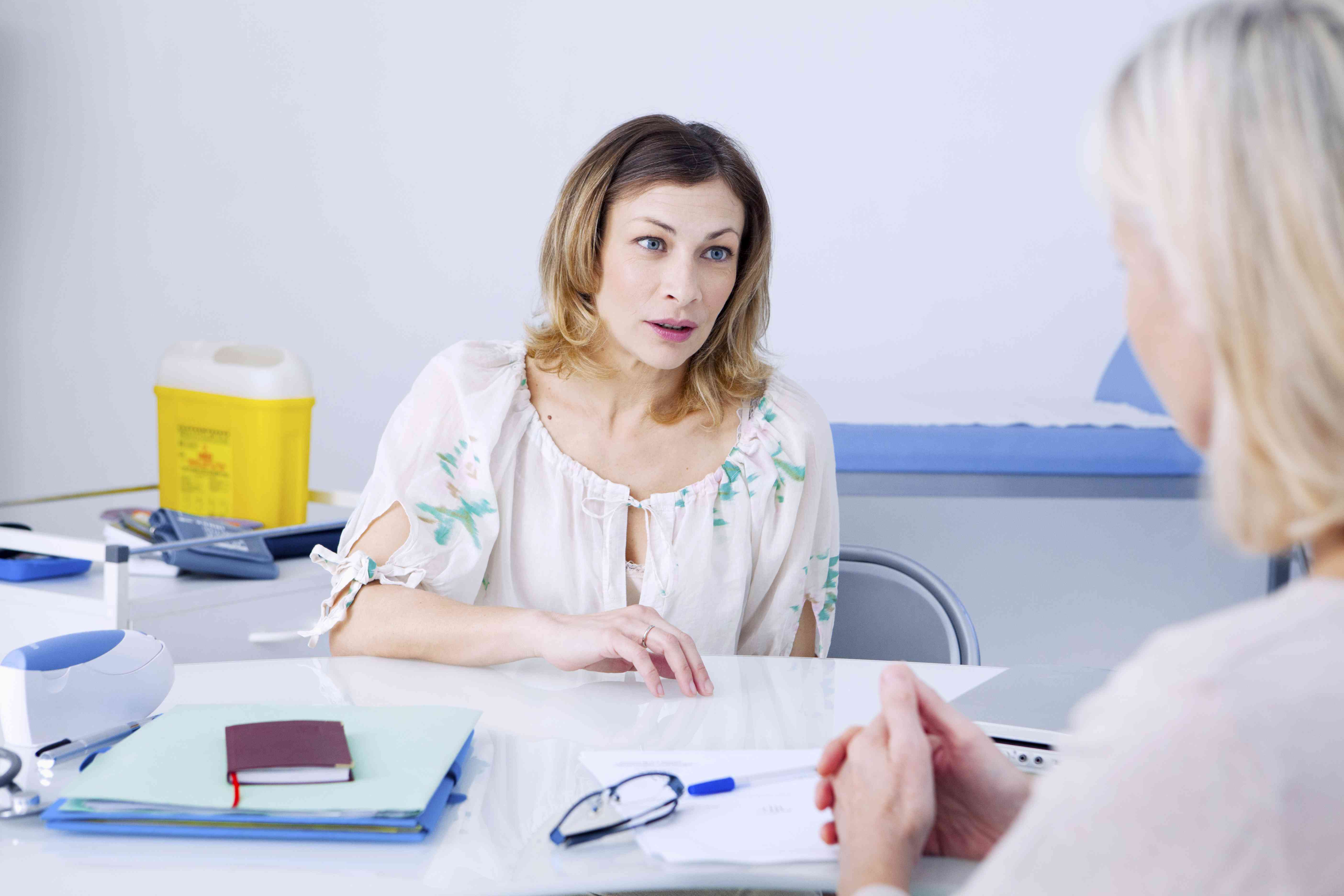 Woman consulting doctor for menopause symptoms