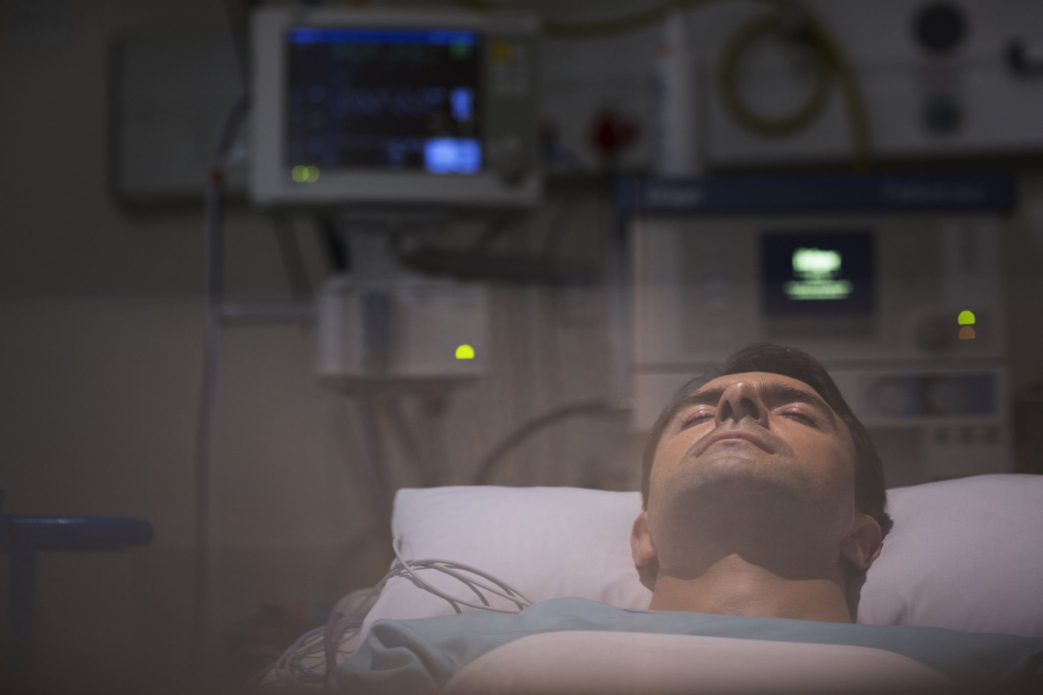A man laying in a coma in the hospital
