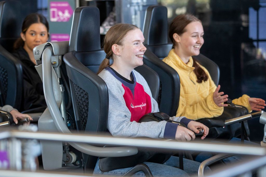 Young girls on rollercoaster ride