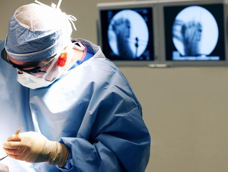 Orthopedic surgeon operating on foot.
