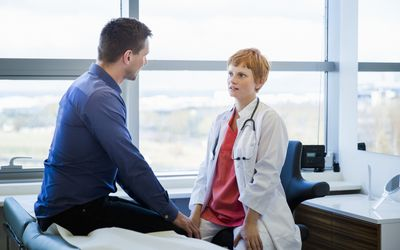 Doctor having discussion with male patient