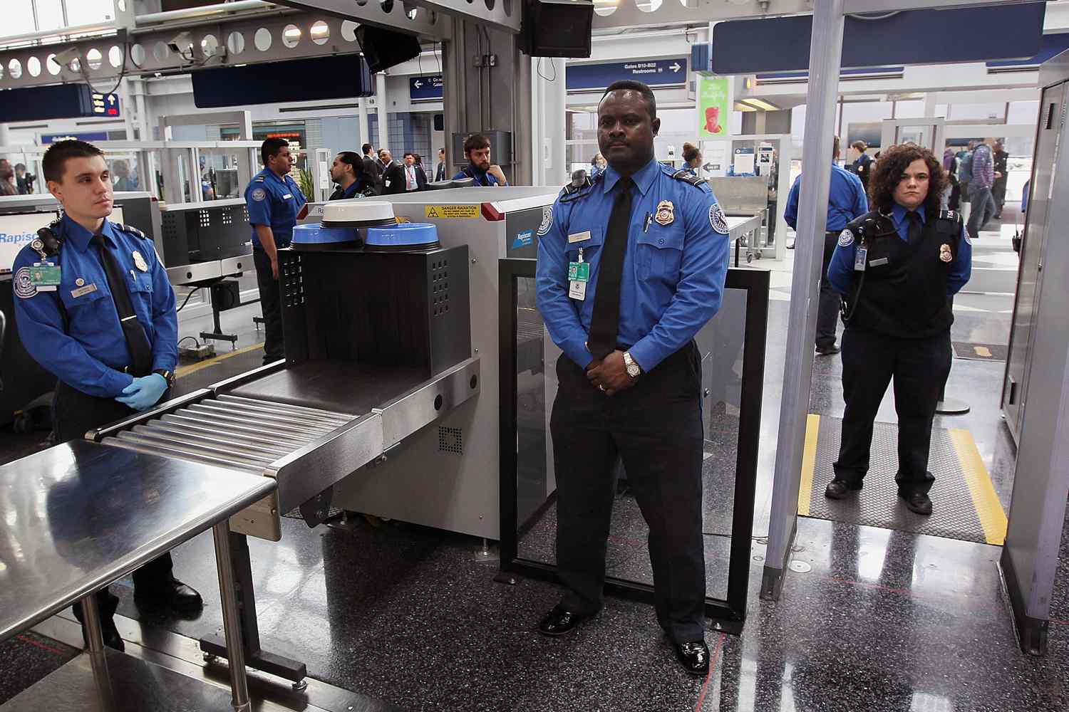 Airport security officers standing at attention