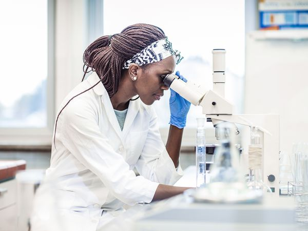 Scientist examining biopsy