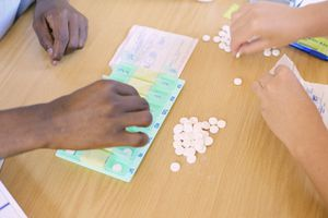 Doctor Teaching Patients How to Use Pill Dispenser