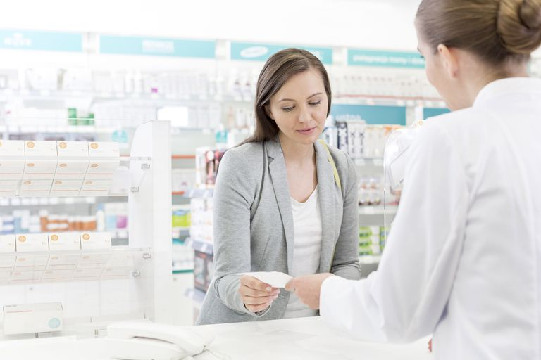A woman receiving her cyclosporine prescription