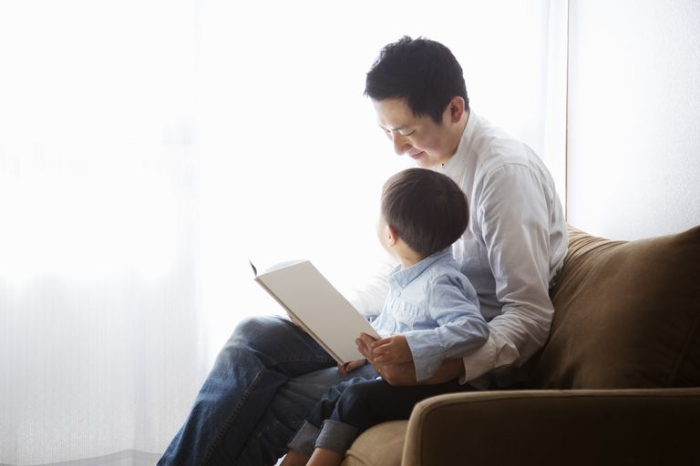 a father and son reading together