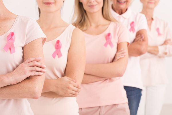Women wearing pink ribbons for breast cancer awareness