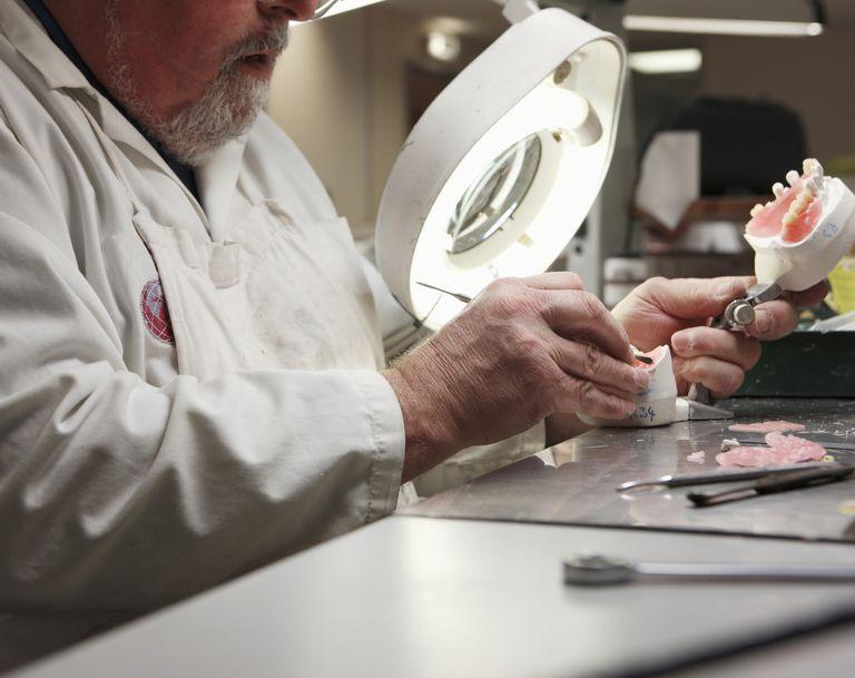 lab technician working on dental impression