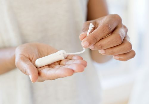 Woman holding tampon