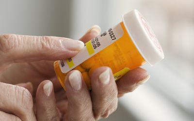 Woman Holding Prescription Bottle