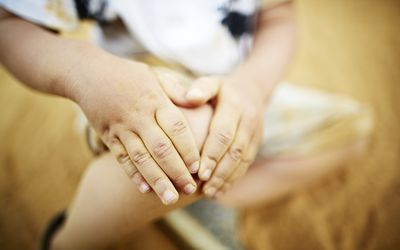Boy Holding Knee