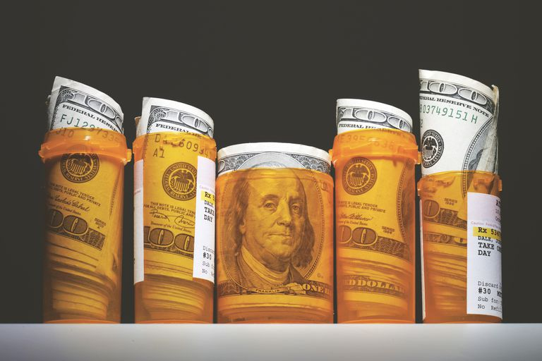 Dollar bills in prescription pill bottles