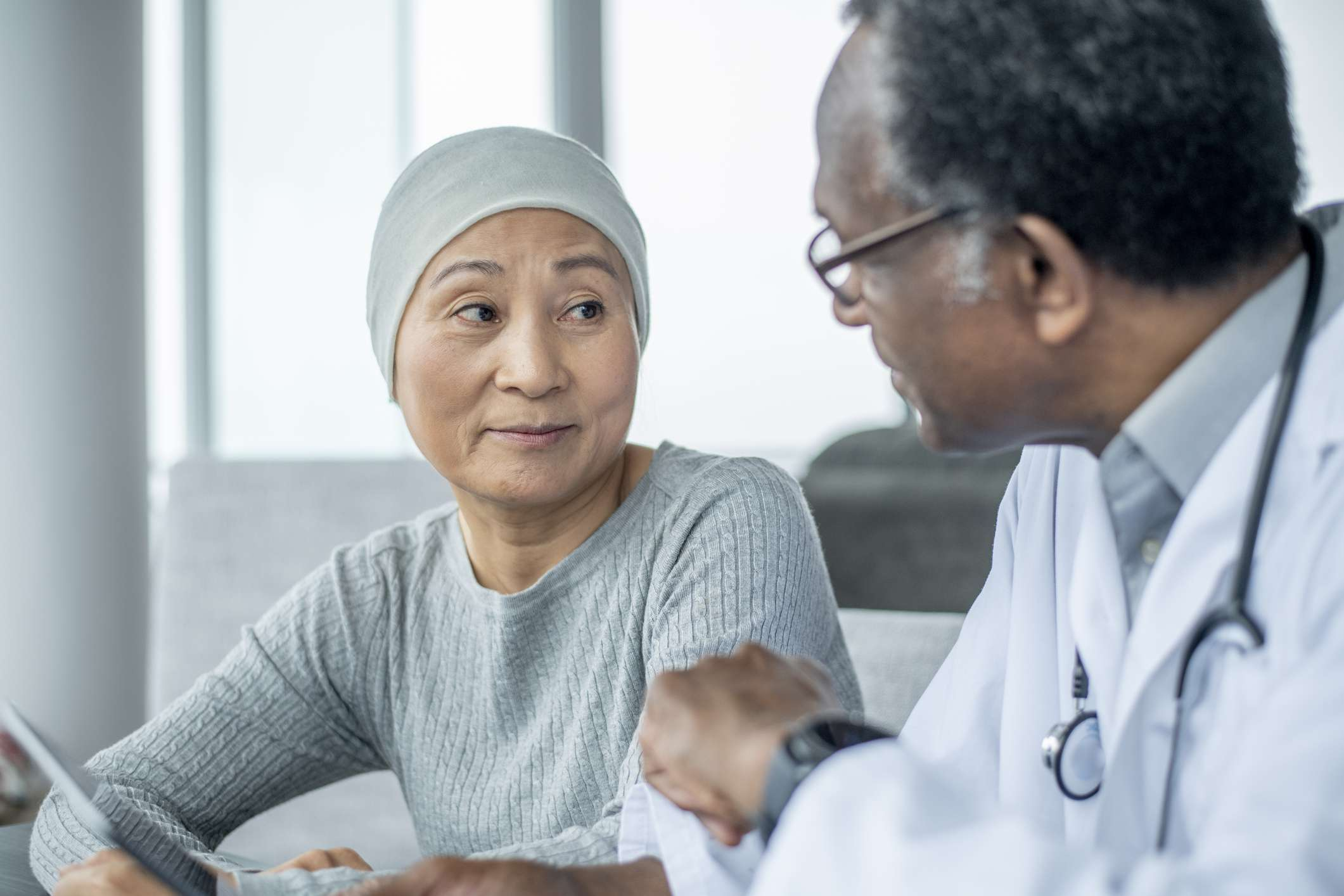 A cancer patient with her doctor