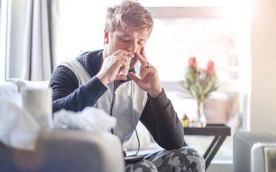 Male adult using nasal spray