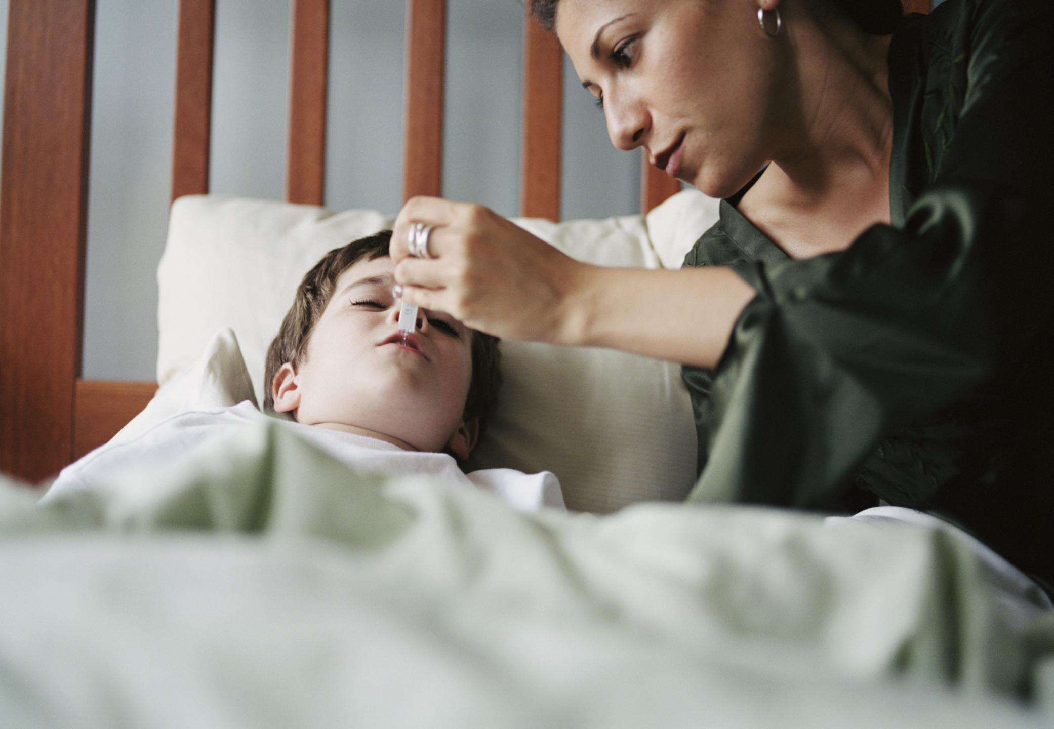 Mother checking child's temperature