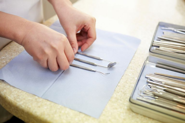 Dental assistant preparing instruments, close up