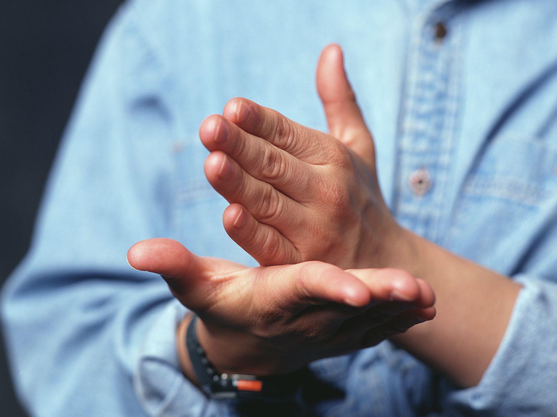A man's hands making a gesture