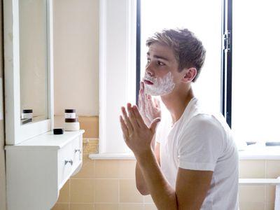 Teen age boy shaving