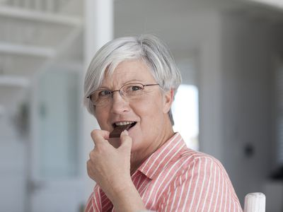 mature woman eating chocolate