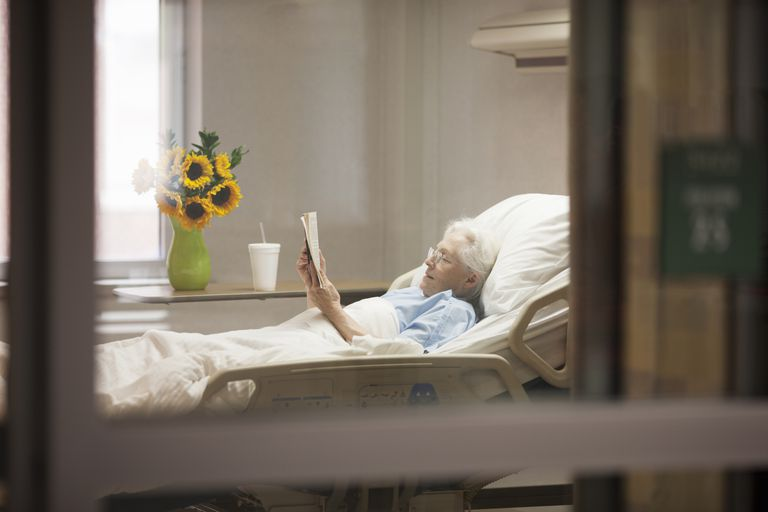 Elderly woman in a hospital bed.
