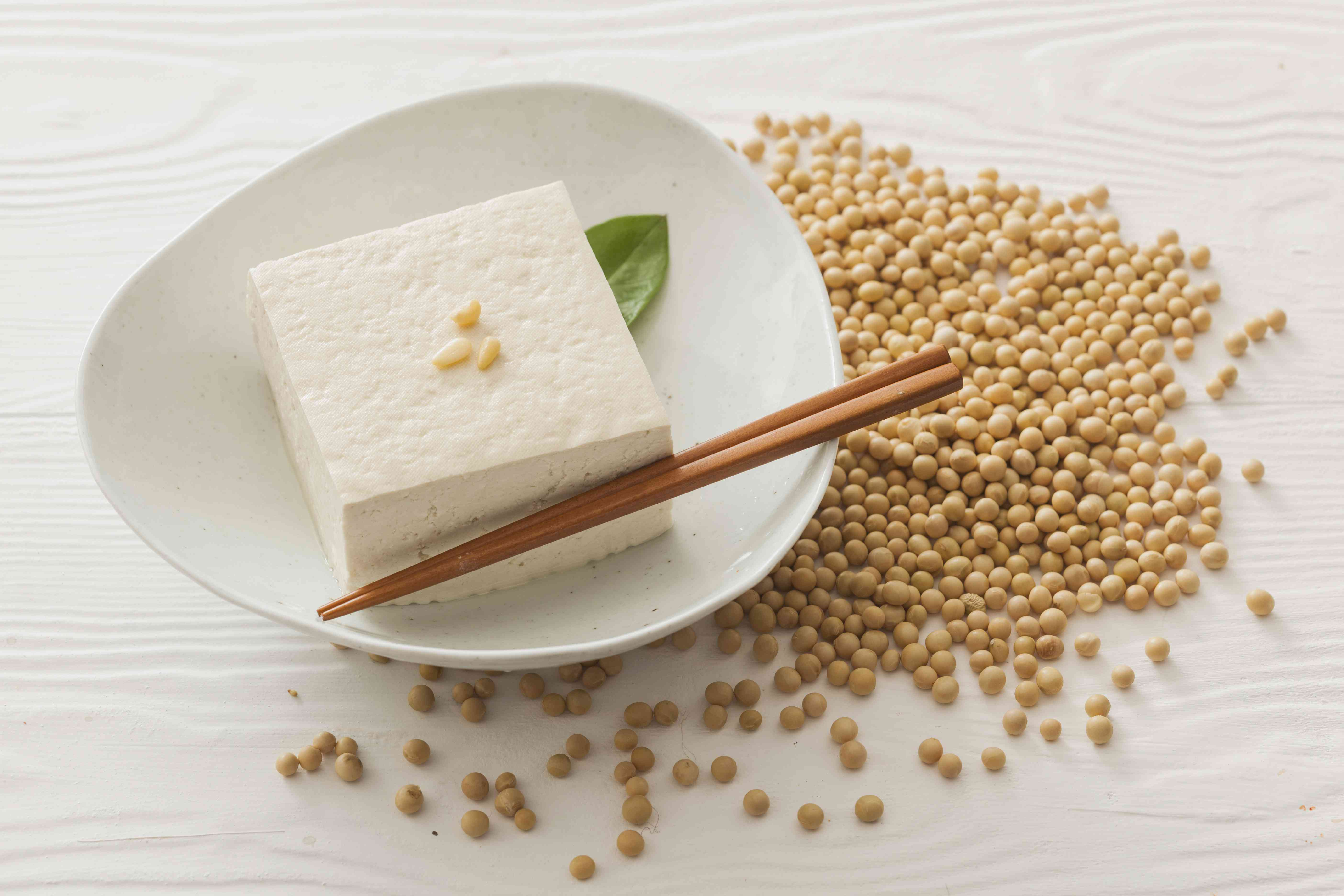 Soy beans and tofu on a white plate
