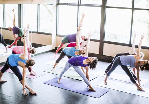 group of people in yoga class