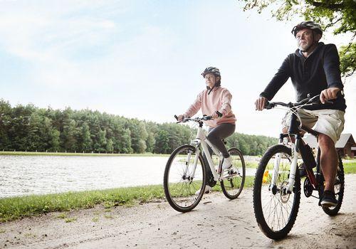 Mature couple cycling