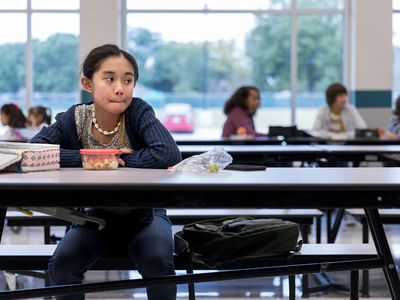 Lonely middle school student in cafeteria