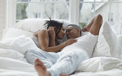 Couple In Bed, Gazing Into Each Other's Eyes